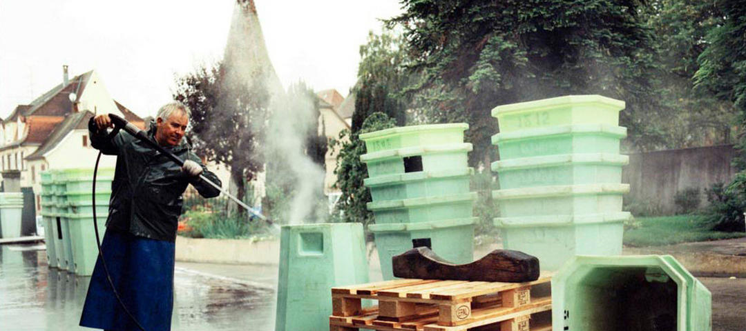 Crates being sprayed with a powerhose at harvest.